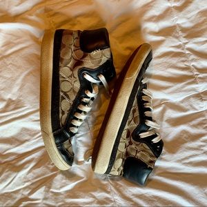 Brown and tan Coach high top shoes.